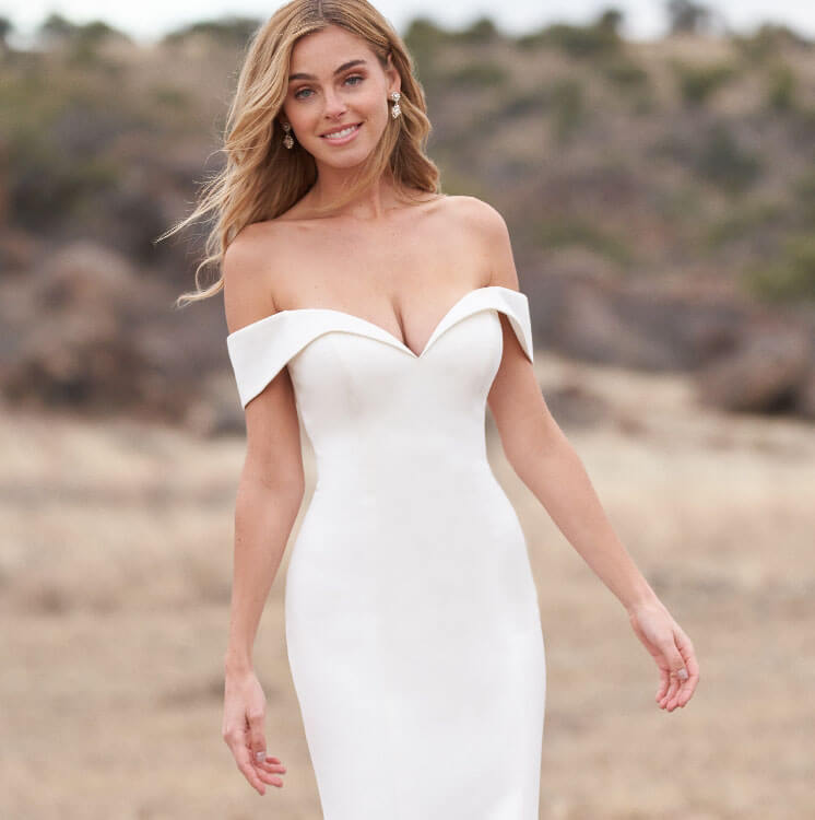 Model wearing a off the shoulder white gown