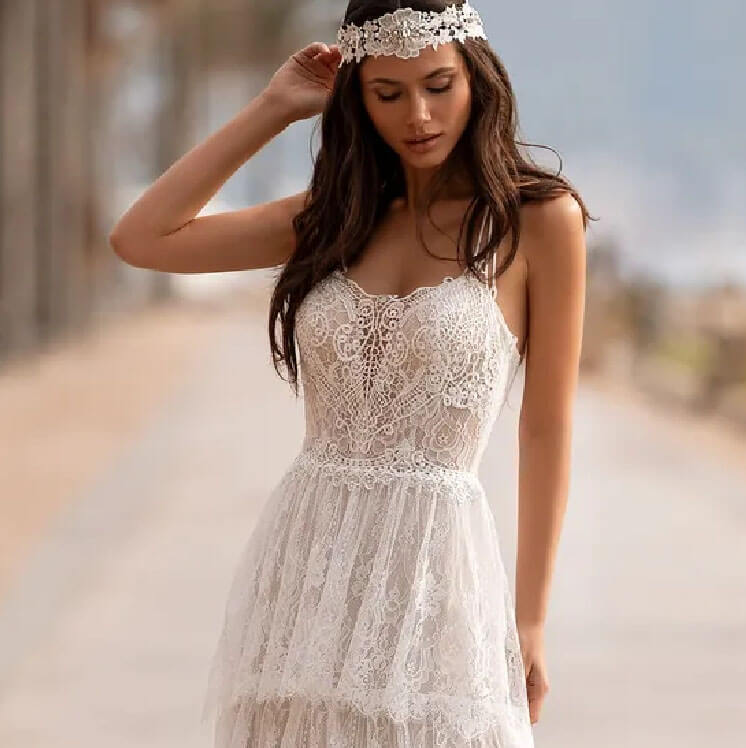 Model wearing a boho white gown